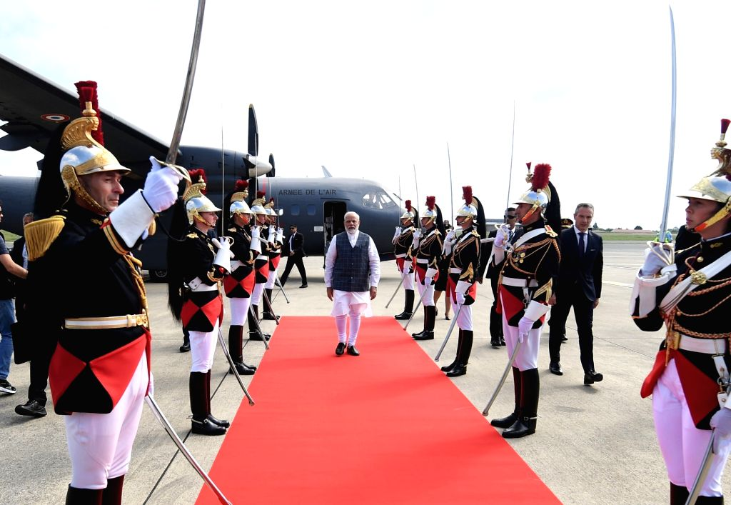 Prime Minister Narendra Modi being welcomed on his arrival at Biarritz to participate in the G7 Summit, in France on Aug 25, 2019. - Narendra Modi