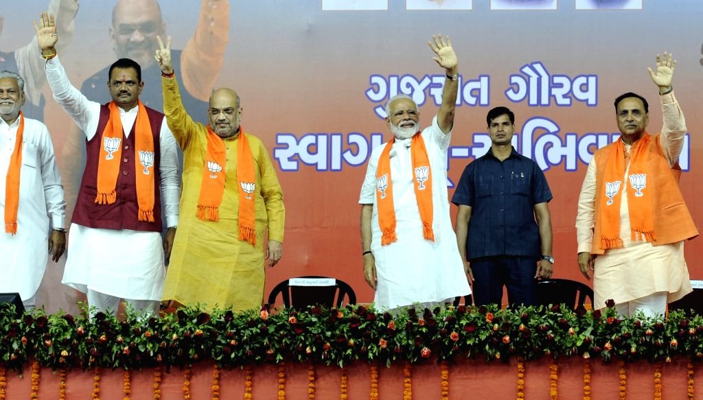 Prime Minister Narendra Modi, BJP chief Amit Shah and Gujarat Chief Minister Vijay Rupani during a public meeting in Ahmedabad on May 26, 2019. - Narendra Modi and Amit Shah