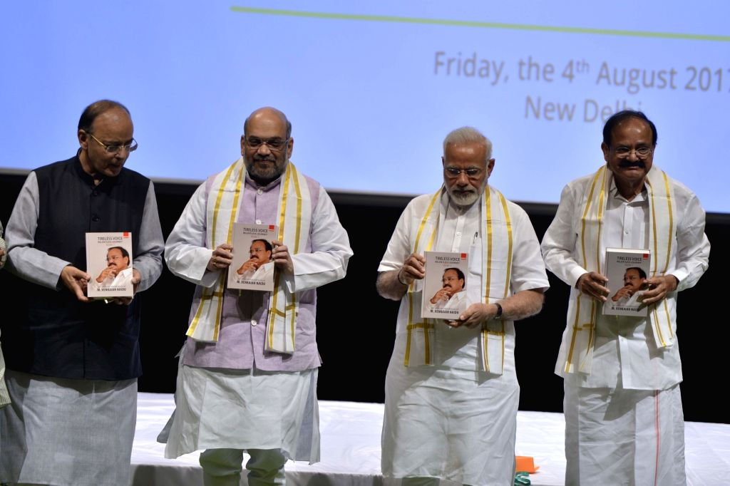"Prime Minister Narendra Modi, BJP president Amit Shah, Union Finance Minister Arun Jaitley during the release of a book ""Tireless Voice Relentless Journey"" written by NDA's ... - Narendra Modi, Venkaiah Naidu, Amit Shah and Arun Jaitley"