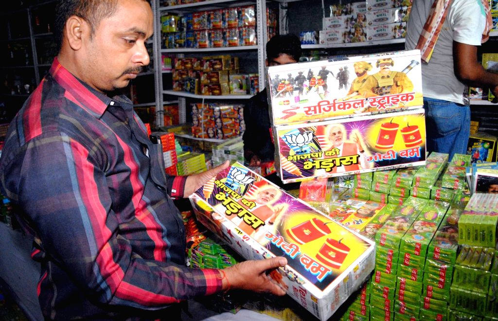 """Prime Minister Narendra Modi bomb"""" and """"Surgical Strike"""" brand crackers on display at a cracker shop in Allahabad on Oct 26, 2016. Crackers branded on other current ... - Narendra Modi"""