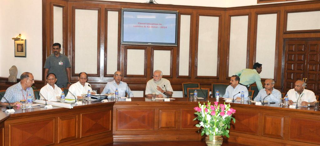 Prime Minister Narendra Modi chairs a high level emergency meeting to review relief operations in Jammu and Kashmir, in New Delhi on September 10, 2014. - Narendra Modi