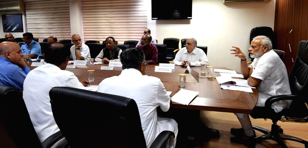 Prime Minister Narendra Modi chairs a high level meeting with the officials to take stock of the flood rescue and relief operations along with Kerala Governor  Justice (Retd.) P. Sathasivam ... - Narendra Modi