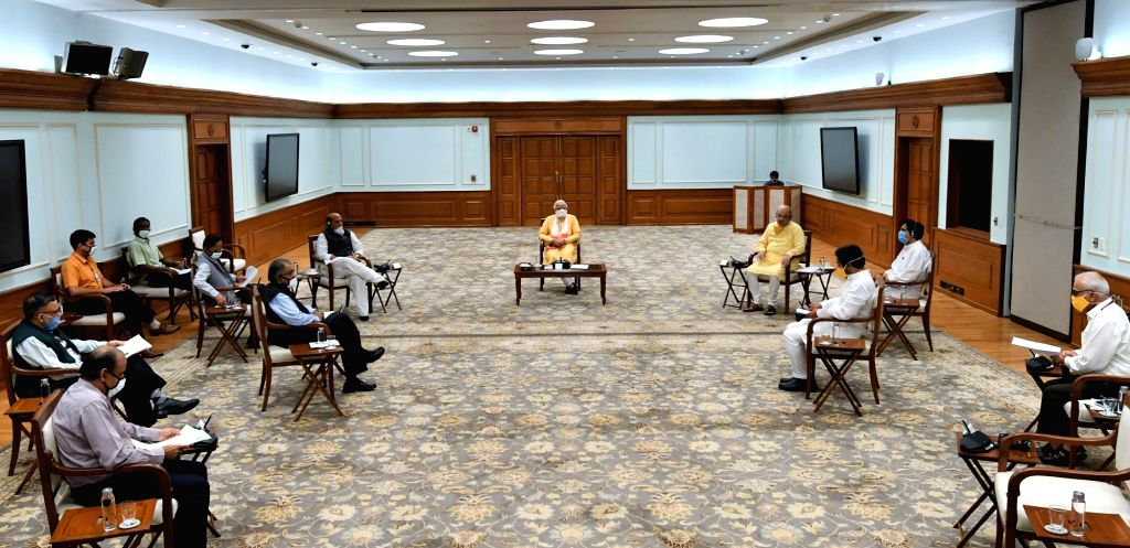 Prime Minister Narendra Modi chairs a meeting of the National Disaster Management Authority in the wake of a gas leak incident in Andhra Pradesh's Visakhapatnam; in New Delhi on May 7, ... - Narendra Modi