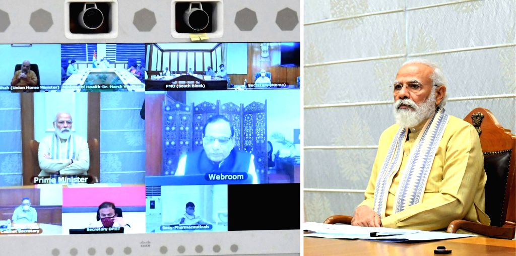 Prime Minister Narendra Modi chairs a meeting to take stock of the coronavirus situation across the country and the preparedness of different states via video conferencing, in New Delhi on ... - Narendra Modi