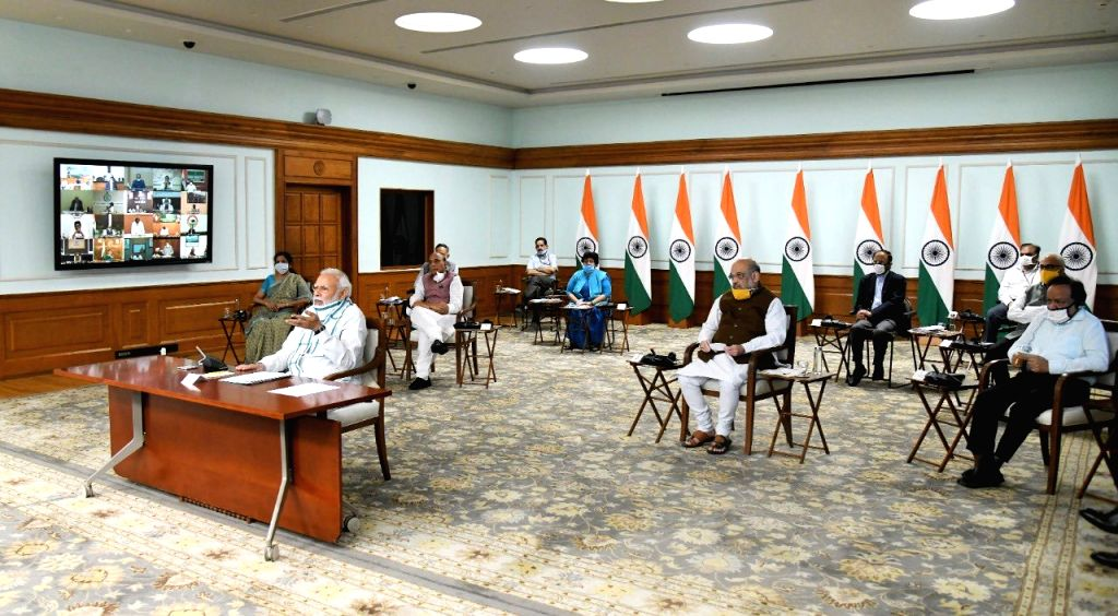Prime Minister Narendra Modi chairs the 4th interaction with Chief Ministers of all states and Union territories through video conferencing in New Delhi during the extended nationwide ... - Narendra Modi, Nirmala Sitharaman, Rajnath Singh, Amit Shah and Harsh Vardhan