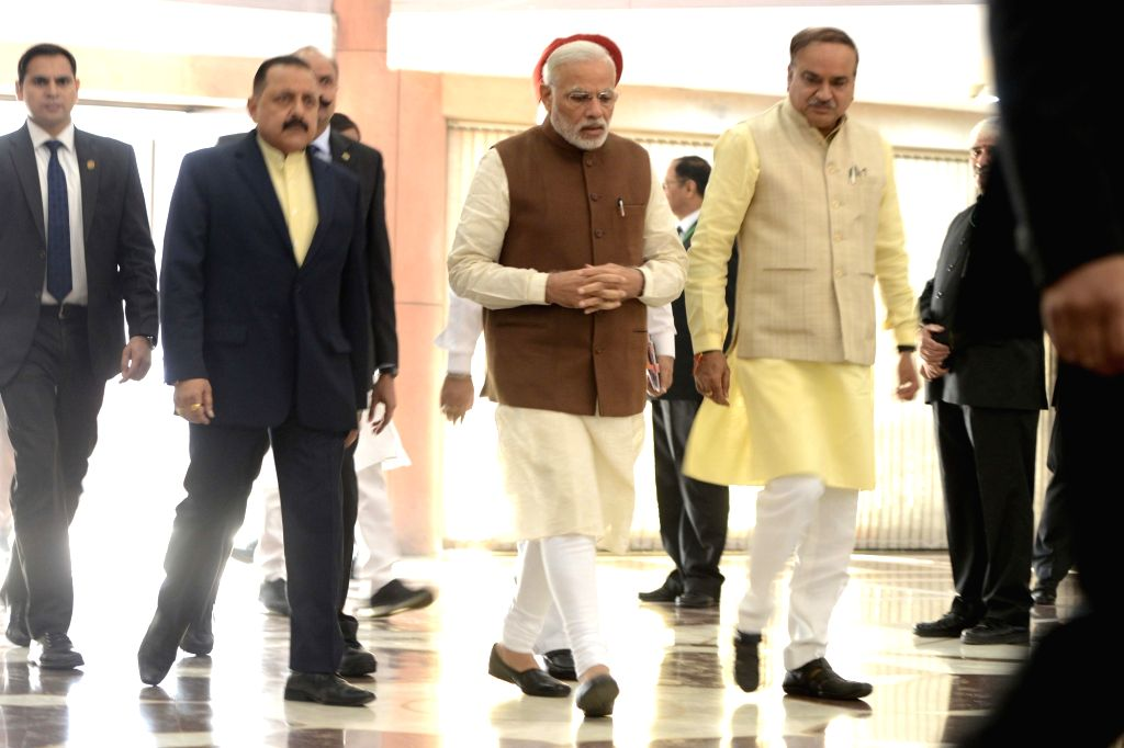 Prime Minister Narendra Modi comes out after BJP Parliamentary Party meeting at Parliament in New Delhi on Nov 29, 2016. Also seen Union Chemical and Fertilizer Minister Ananth Kumar. - Narendra Modi and Ananth Kumar
