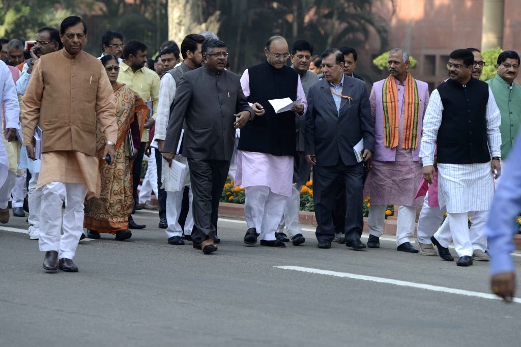 Prime Minister Narendra Modi comes out after BJP Parliamentary Party meeting at Parliament in New Delhi on Nov 29, 2016. Also seen Union MoS PMO Jitendra Singh and Union Chemical and ... - Narendra Modi, Jitendra Singh and Ananth Kumar