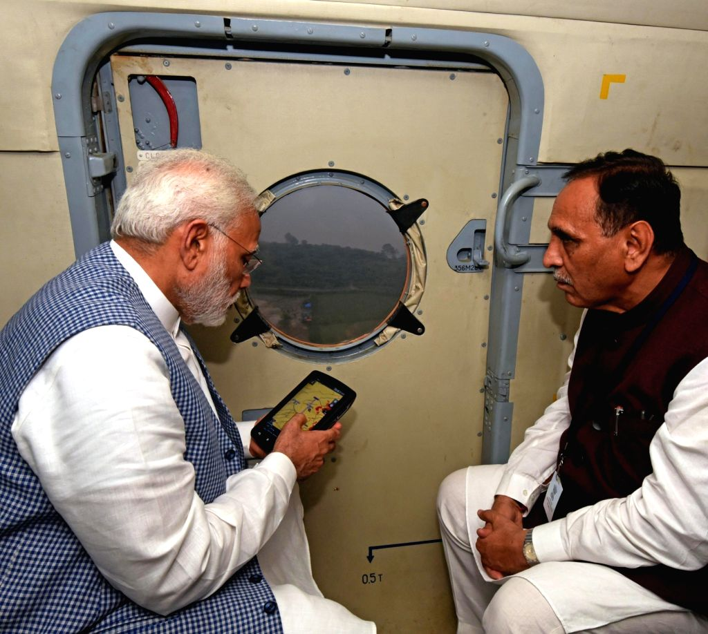 Prime Minister Narendra Modi conducts aerial survey of flood affected areas of Gujarat on July 25, 2017. Also seen Gujarat Chief Minister Vijay Rupani. - Narendra Modi