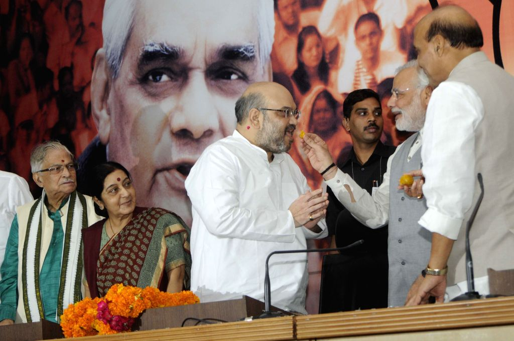 Prime Minister Narendra Modi congratulates new BJP chief Amit Shah on his elevation during a press conference  in New Delhi on July 9, 2014. Also seen senior BJP leader Murli Manohar Joshi, External . - Narendra Modi, Sushma Swaraj, Murli Manohar Joshi and Rajnath Singh