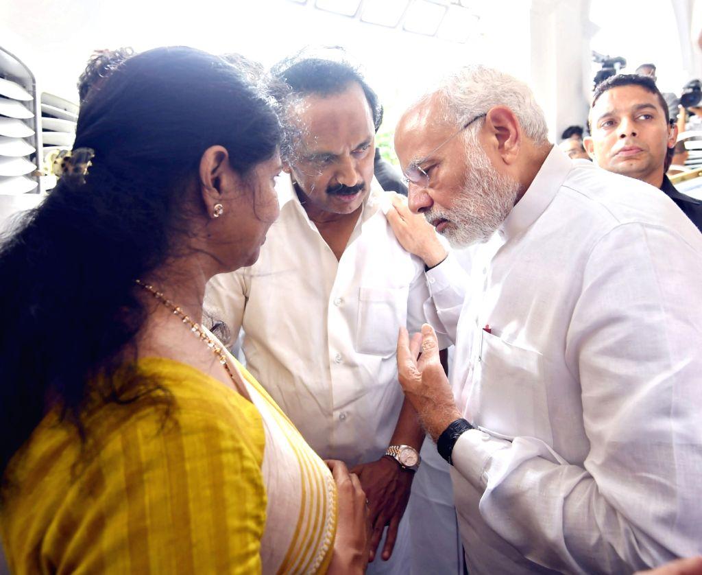 Prime Minister Narendra Modi consoles late DMK President M. Karunanidhi's children M.K. Stalin and Kanimozhi, in Chennai on Aug 8, 2018. - Narendra Modi