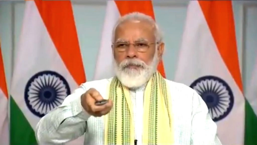 Prime Minister Narendra Modi dedicates to the nation a 750-MW solar project - said to be Asia's biggestat Rewa in Madhya Pradesh through video conferencing from New Delhi on July 10, ... - Narendra Modi