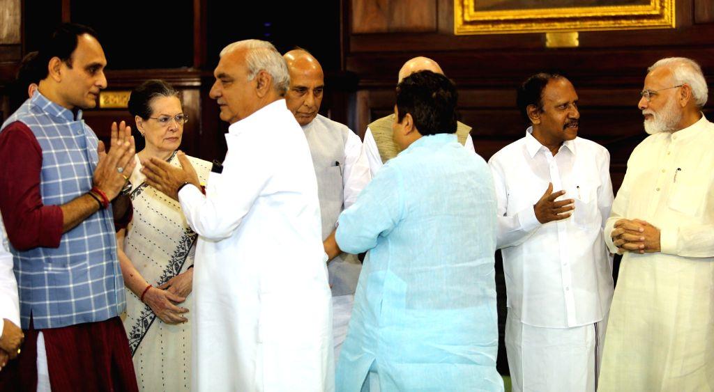 Prime Minister Narendra Modi, Defence Minister Rajnath Singh, Congress interim president Sonia Gandhi, Congress leader Bhupinder Singh Hooda, Senior BJP leader LK Advani, AIADMK leader M. ... - Narendra Modi, Rajnath Singh, Sonia Gandhi and Bhupinder Singh Hooda