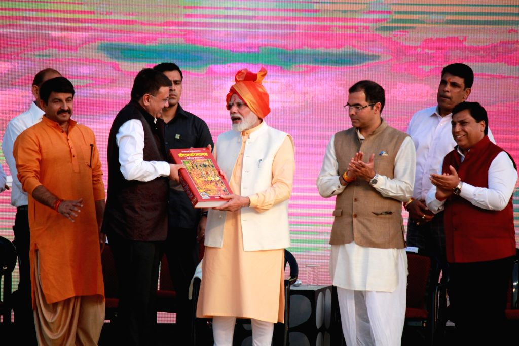 Prime Minister Narendra Modi, Delhi BJP chief Manoj Tiwari and the party's West Delhi MP Parvesh Verma during Ram Leela at Dwarka, New Delhi on Oct 8, 2019. - Narendra Modi and Parvesh Verma