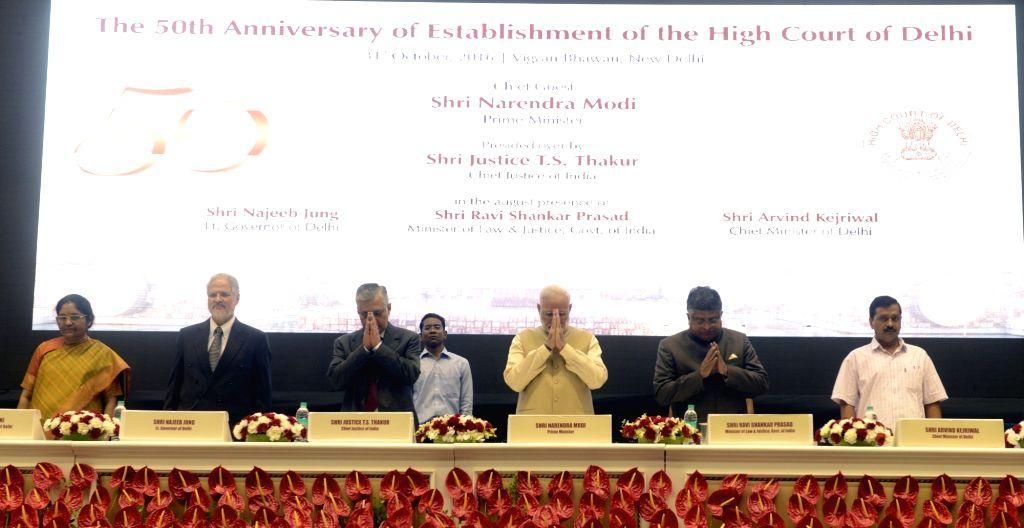 Prime Minister Narendra Modi, Delhi Lt. Governor Najeeb Jung, Delhi Chief Minister Arvind Kejriwal, Union Minister for Electronics & Information Technology and Law & Justice Ravi ... - Narendra Modi and Arvind Kejriwal
