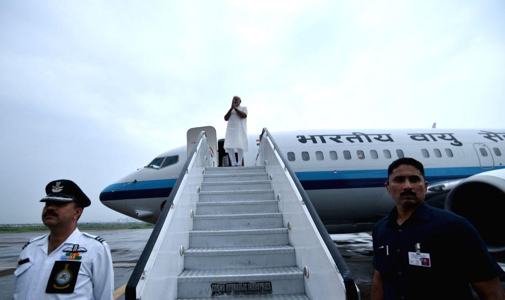Prime Minister Narendra Modi departs for Delhi from Gujarat on Sept 17, 2016. - Narendra Modi