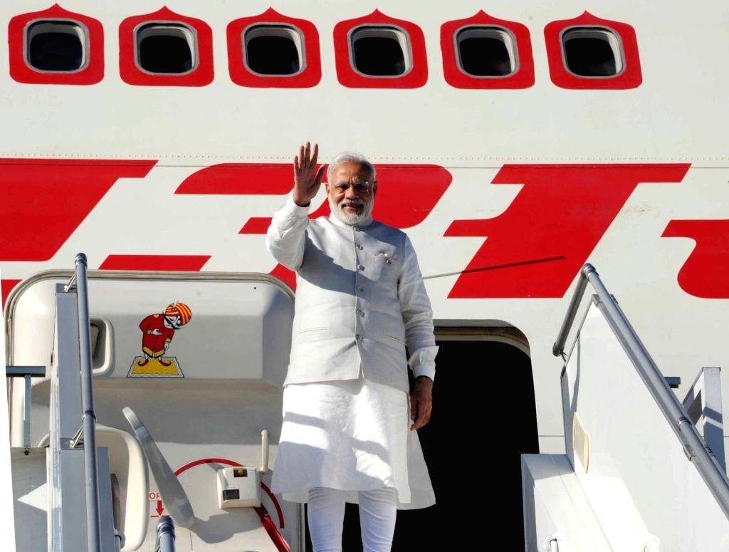 Prime Minister Narendra Modi departs from Tashkent after the Shanghai Cooperation Organisation (SCO) summit, in Tashkent, Uzbekistan on June 24, 2016. - Narendra Modi