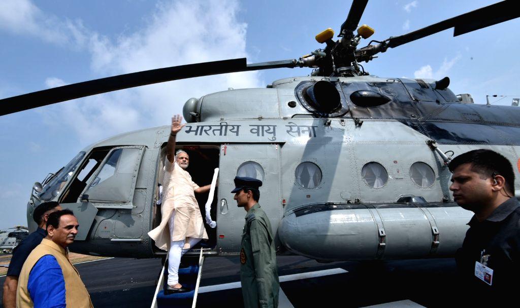 Prime Minister Narendra Modi departs from Limkheda, Gujarat on Sept 17, 2016. Also seen Gujarat Chief Minister Vijay Rupani. - Narendra Modi