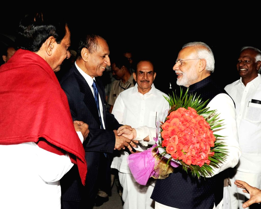 Prime Minister Narendra Modi departs from Hyderabad after attending the Annual Conference of DGs/IGs of Police on Nov 26, 2016. Also seen Andhra Pradesh and Telangana Governor ESL ... - Narendra Modi and N Chandrababu Naidu