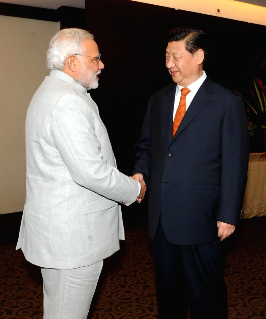 Prime Minister Narendra Modi during a meeting with President of the People's Republic of China Xi Jinping on the sidelines of 6th BRICS Summit in Fortaliza, Brazil on July 14, 2014. Modi called for .. - Narendra Modi