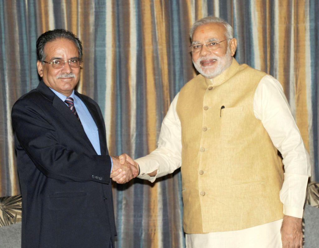 Prime Minister Narendra Modi during a meeting with UCPN(M) chairman Pushpa Kamal Dahal Prachanda in Kathmandu, Nepal on August 04, 2014. - Narendra Modi