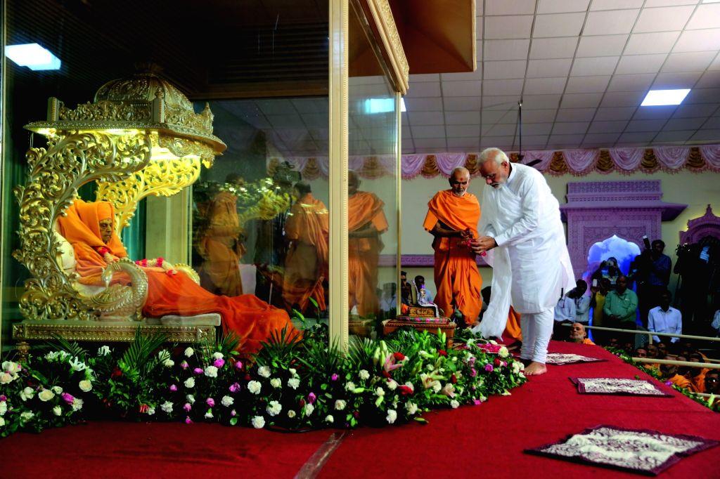 Prime Minister Narendra Modi during a programme organised to pay tribute to Swaminarayan Sect Pramukh Swami Maharaj at BAPS Shri Swaminarayan Mandir near Botad in Gujarat on Aug 15, 2016. - Narendra Modi