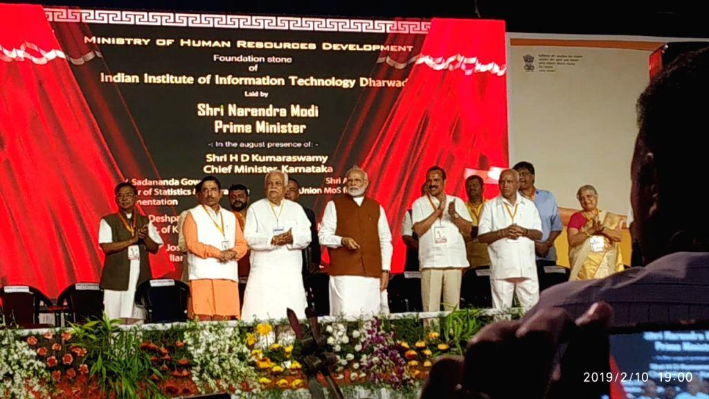 Prime Minister Narendra Modi during a programme organised to launch development projects in Hubli, Karnataka on Feb 10, 2019. - Narendra Modi