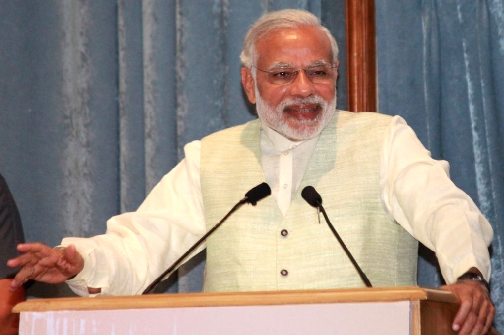 :Prime Minister Narendra Modi during a programme organised on the Legal Service Day organised by National Legal Service Authority, in New Delhi, on Nov 9, 2015. . - Narendra Modi