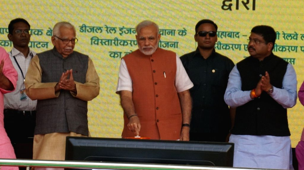 Prime Minister Narendra Modi during a public meeting in Varanasi on Oct 24, 2016. Also seen Uttar Pradesh, Governor Ram Naik and Union Petroleum Minister Dharmendra Pradhan. - Narendra Modi