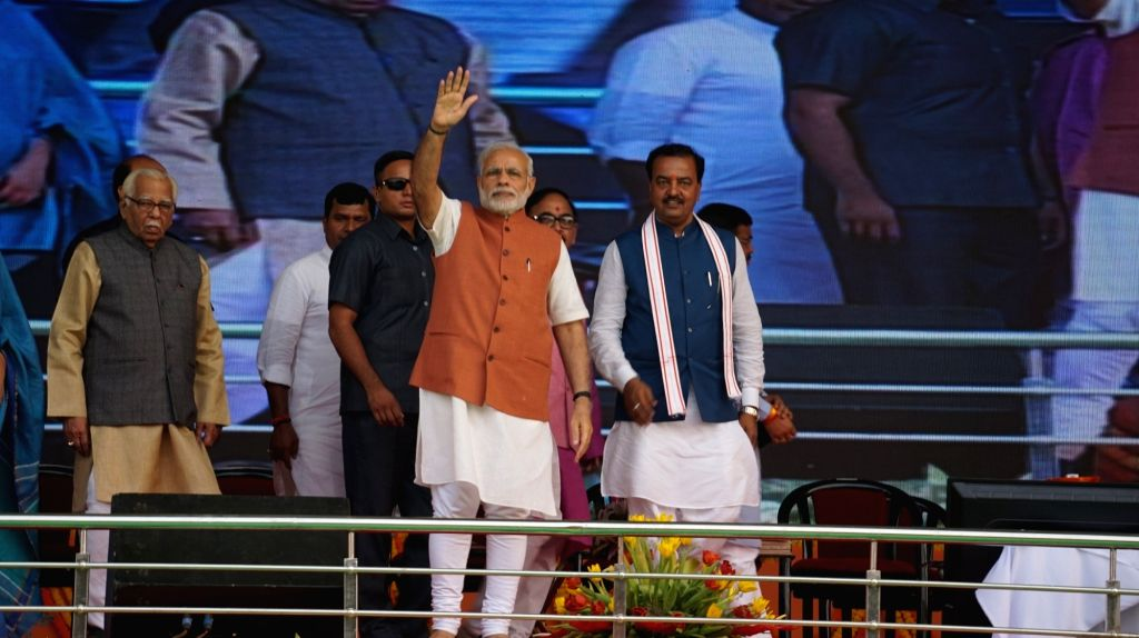 Prime Minister Narendra Modi during a public meeting in Varanasi on Oct 24, 2016. Also seen Uttar Pradesh, Governor Ram Naik. - Narendra Modi