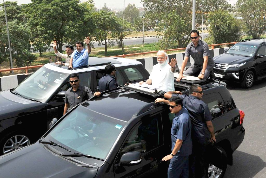 Prime Minister Narendra Modi during a road show after inaugurating the first phase of Delhi-Meerut Expressway, in New Delhi on May 27, 2018. The Prime Minister's road show commenced from ... - Narendra Modi