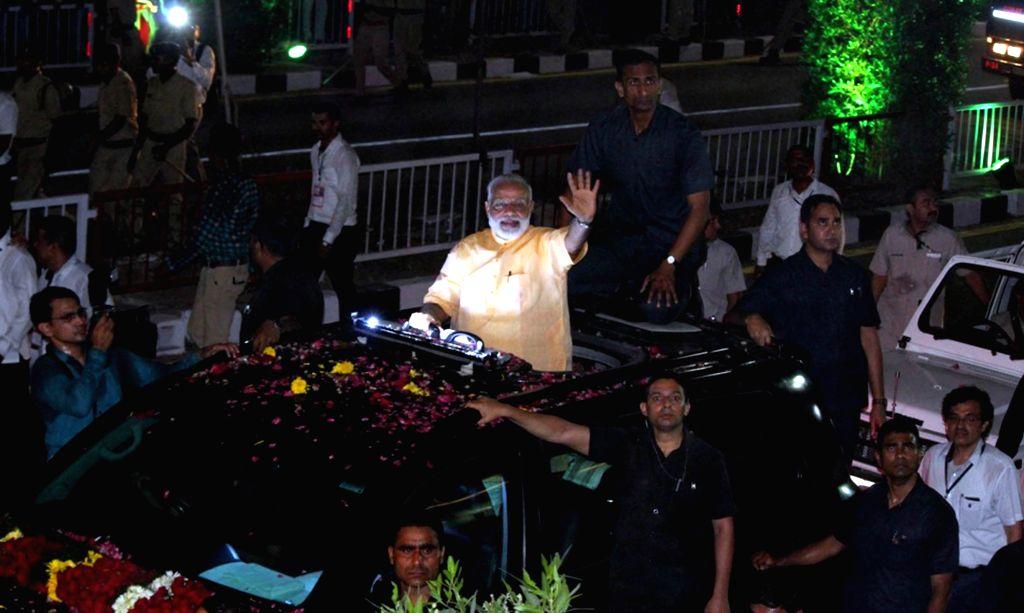 Prime Minister Narendra Modi during a roadshow in Surat on April 16, 2017. - Narendra Modi