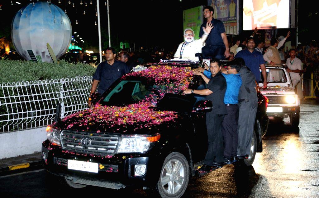Prime Minister Narendra Modi during a roadshow in Rajkot, Gujarat on June 29, 2017. - Narendra Modi