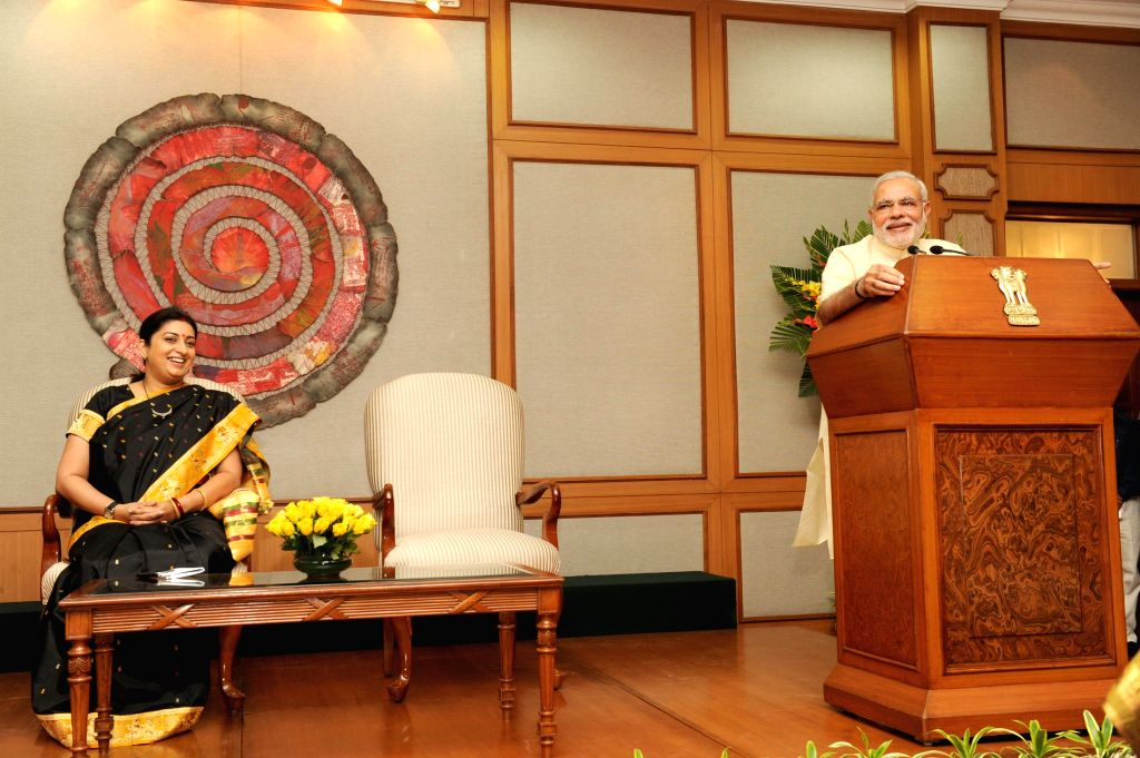 Prime Minister Narendra Modi during an interaction with teachers nominated for various awards on the eve of teachers day in New Delhi on September 04, 2014. Also seen Union HRD Minister Smriti Z ... - Narendra Modi and Smriti Z Irani