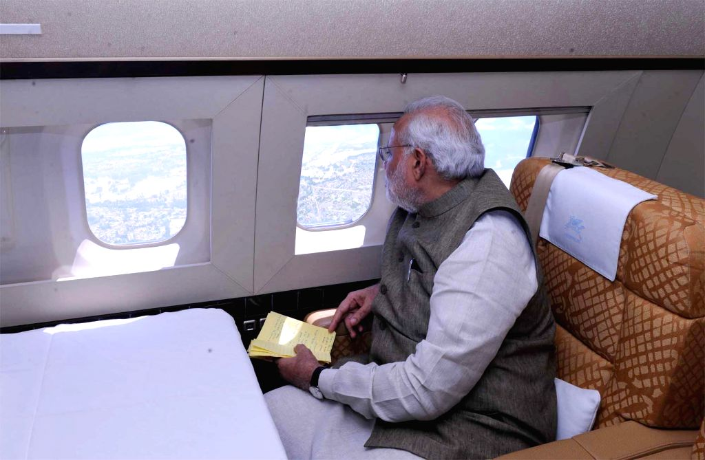 Prime Minister Narendra Modi during an aerial inspection of flood hit Jammu and Kashmir on September 07, 2014. - Narendra Modi
