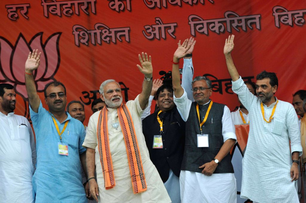 Prime Minister Narendra Modi during the `Parivartan rally` in Saharsa, Bihar, on Aug 18, 2015. Also seen Union Minister for Consumer Affairs, Food and Public Distribution Ramvilas Paswan, ... - Narendra Modi, Mangal Pandey and Sushil Kumar Modi