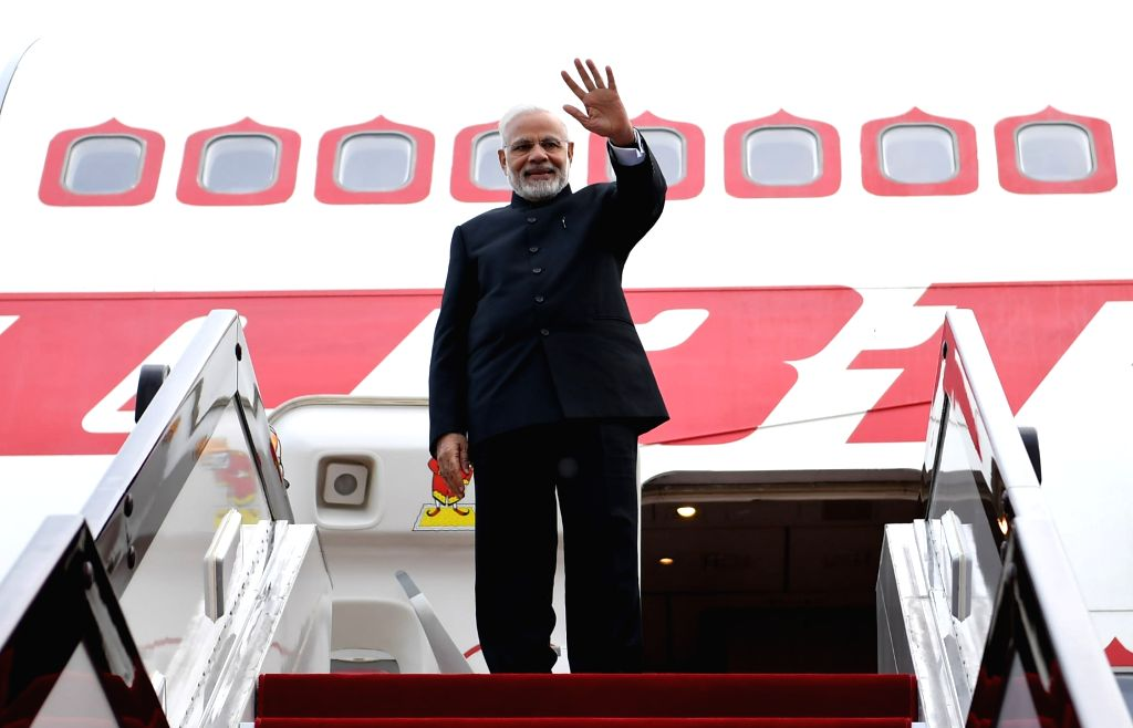 Prime Minister Narendra Modi emplanes for India after attending the Shanghai Cooperation Organisation (SCO) Summit in Qingdao, China on June 10, 2018. - Narendra Modi