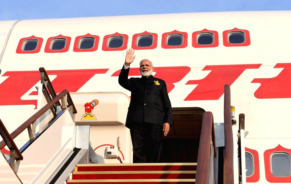 Prime Minister Narendra Modi emplanes for New Delhi after his two-day long state visit to South Korea, on Feb 22, 2019. - Narendra Modi