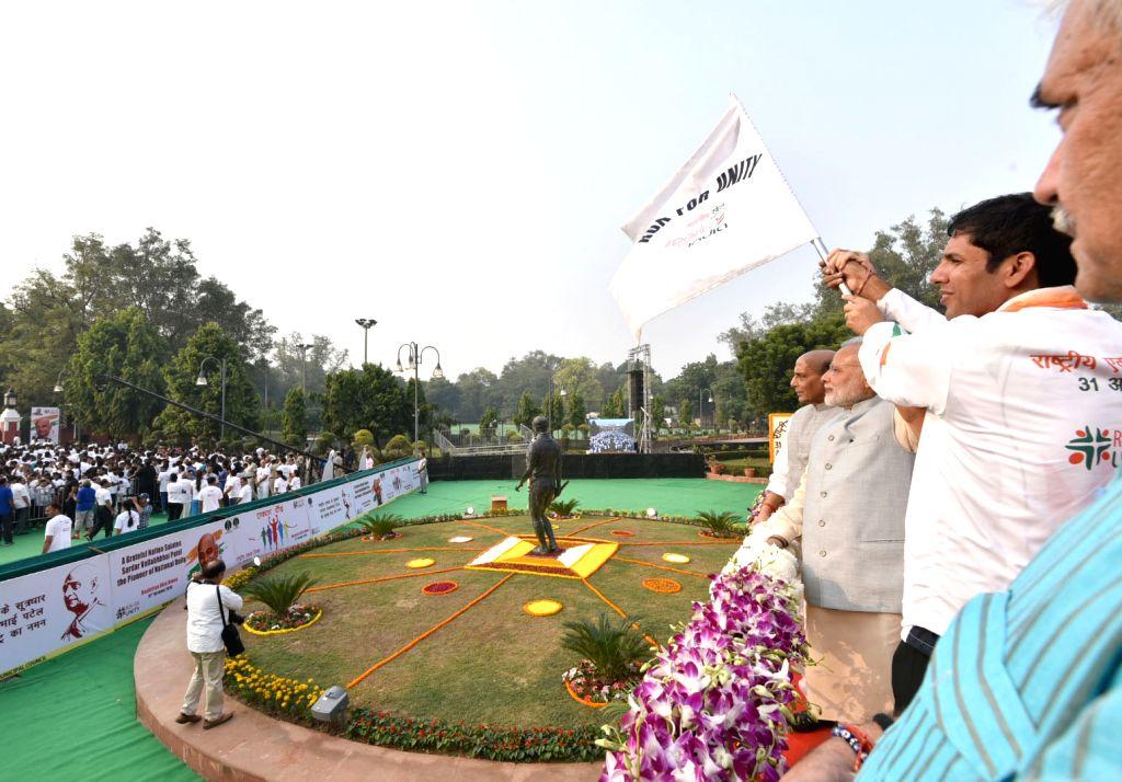 "Prime Minister Narendra Modi flagg off the ""Run for Unity"" on the occasion of Rashtriya Ekta Diwas at National Stadium in New Delhi on Oct 31, 2016. Also seen Union Home Minister ... - Narendra Modi and Rajnath Singh"