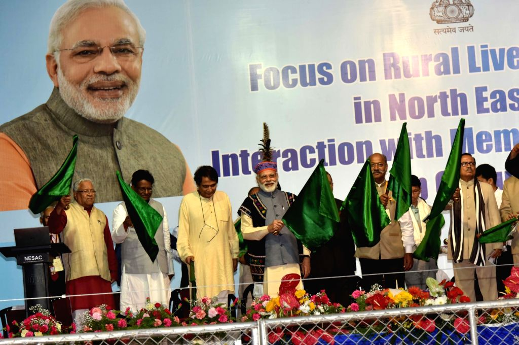 Prime Minister Narendra Modi flags off new passenger trains for North East, at the public meeting, in Shillong on May 27, 2016. - Narendra Modi