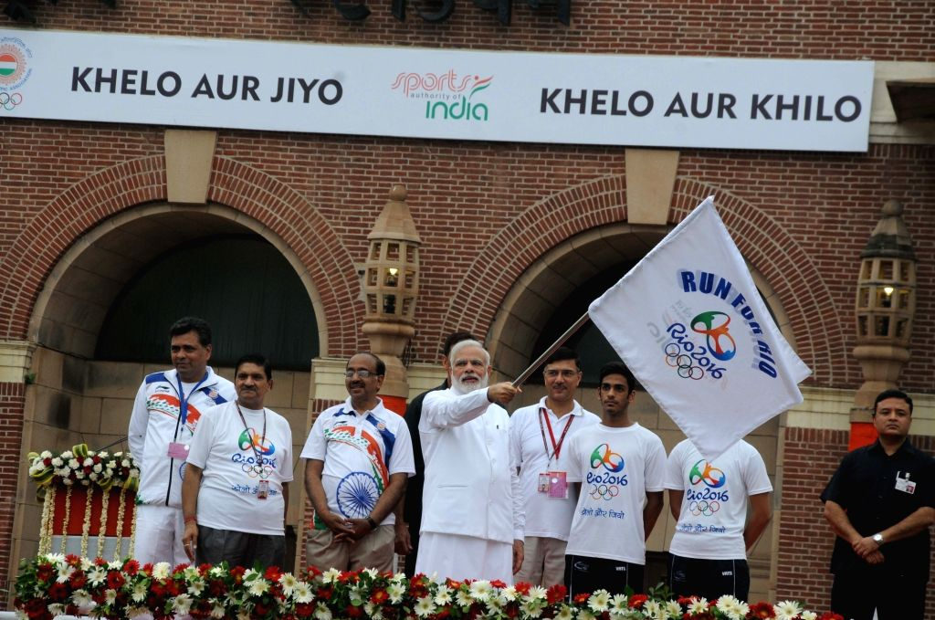 "Prime Minister Narendra Modi flags-off  ""Run for Rio"" at National Stadium in New Delhi on July 31, 2016. - Narendra Modi"
