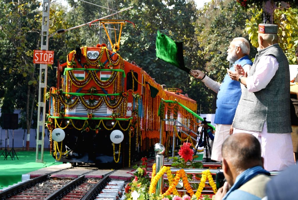 Prime Minister Narendra Modi flags off the world's first diesel to electric converted locomotive in Varanasi, on Feb 19, 2019. - Narendra Modi