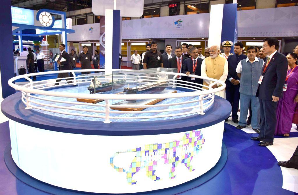 Prime Minister Narendra Modi going around the exhibition at Maritime India Summit, in Mumbai on April 14, 2016. The Governor of Maharashtra, C. Vidyasagar Rao, the Union Minister for Road ... - Narendra Modi, C. Vidyasagar Rao and Anandiben Patel