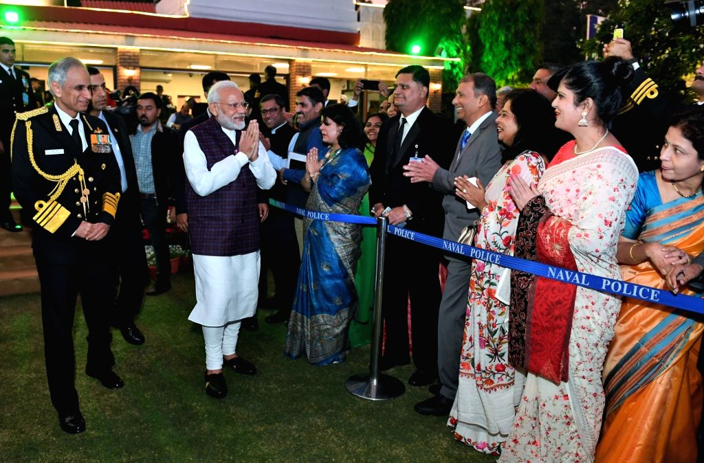 Prime Minister Narendra Modi greets Navy personnel and their spouses during the 'At Home' reception organised on the occasion of Navy Day, in New Delhi on Dec 4, 2019. - Narendra Modi