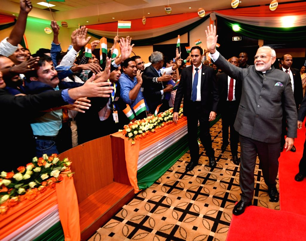 Prime Minister Narendra Modi greets the people on his arrival at a ceremonial reception accorded to him by the Indian Community, in Rwanda's Kigali on July 23, 2018. - Narendra Modi
