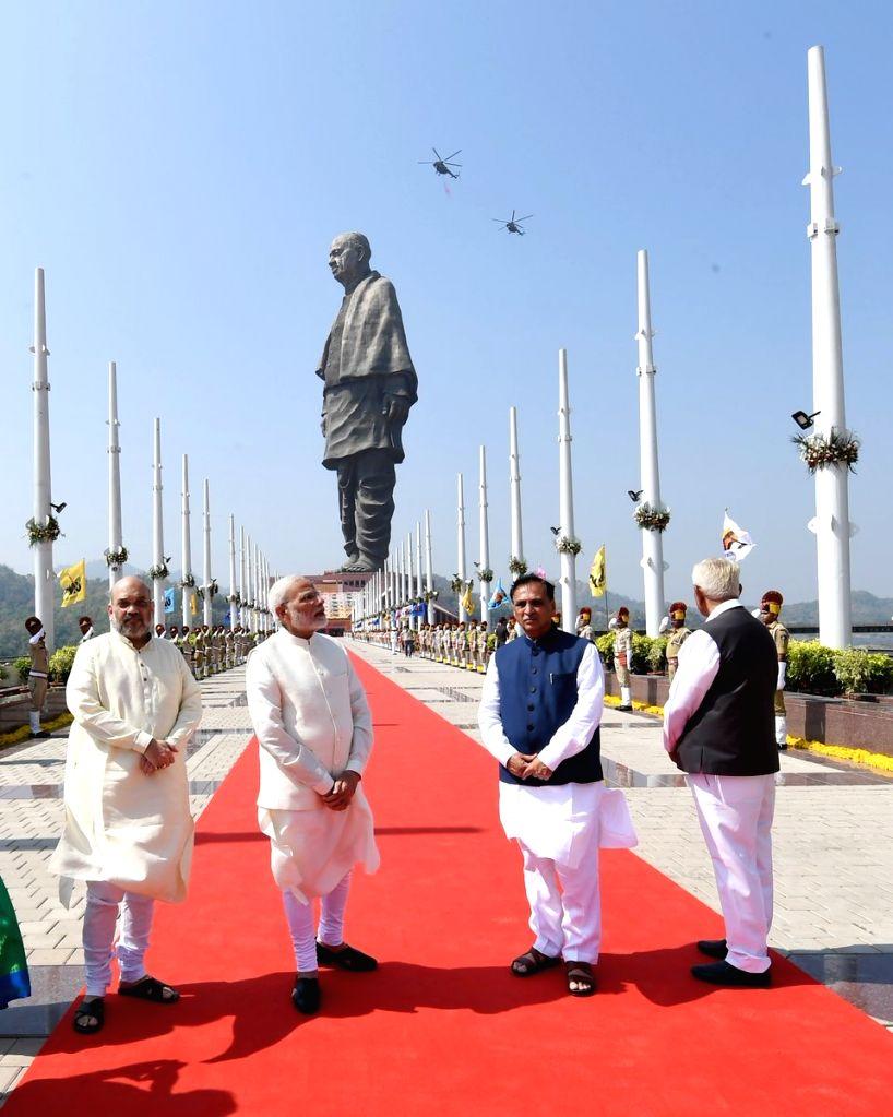 Prime Minister Narendra Modi, Gujarat Chief Minister Vijay Rupani, Karnataka Governor Vajubhai Vala and BJP chief Amit Shah witness flypast by the Indian Air Force (IAF) at the inauguration ... - Narendra Modi, Amit Shah and Sardar Vallabhbhai Patel