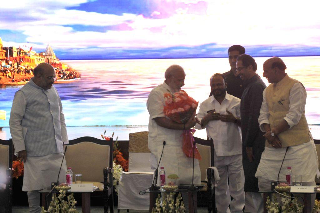 Prime Minister Narendra Modi, Home Minister Rajnath Singh and BJP chief Amit Shah with Shiv Sena chief Uddhav Thackeray during a NDA meeting in New Delhi on April 10, 2017. - Narendra Modi, Rajnath Singh and Amit Shah