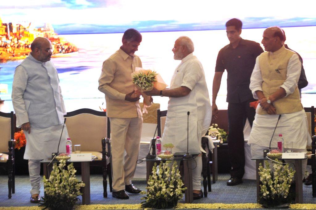 Prime Minister Narendra Modi, Home Minister Rajnath Singh and BJP chief Amit Shah with TDP chief N. Chandrababu Naidu during a NDA meeting in New Delhi on April 10, 2017. - Narendra Modi, Rajnath Singh, Amit Shah and N. Chandrababu Naidu