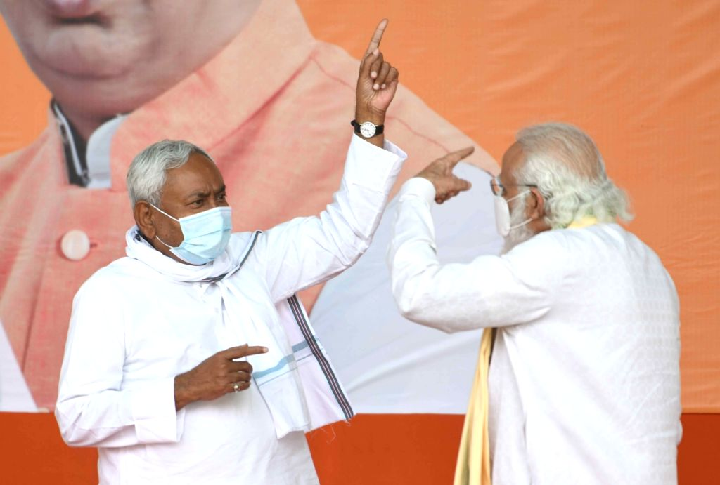 Prime Minister Narendra Modi in a conversation with Bihar Chief Minister Nitish Kumar at a public meeting ahead of Bihar Assembly elections, in Sasaram on Oct 23, 2020. - Narendra Modi and Nitish Kumar