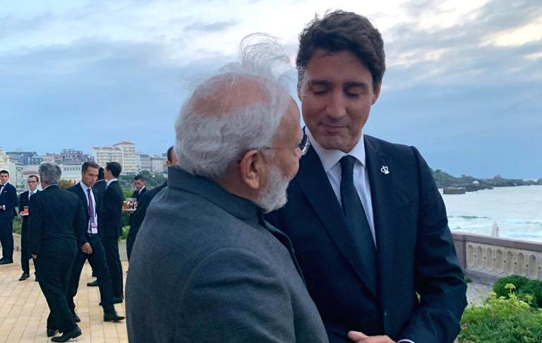 Prime Minister Narendra Modi in a conversation with Canadian Prime Minister Justin Trudeau at the G7 Summit in Biarritz, France on Aug 25, 2019. - Narendra Modi