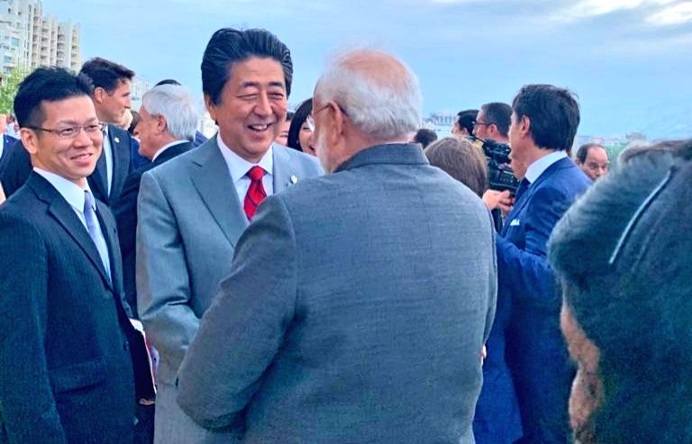 Prime Minister Narendra Modi in a conversation with Japanese Prime Minister Shinzo Abe at the G7 Summit in Biarritz, France on Aug 25, 2019. - Narendra Modi